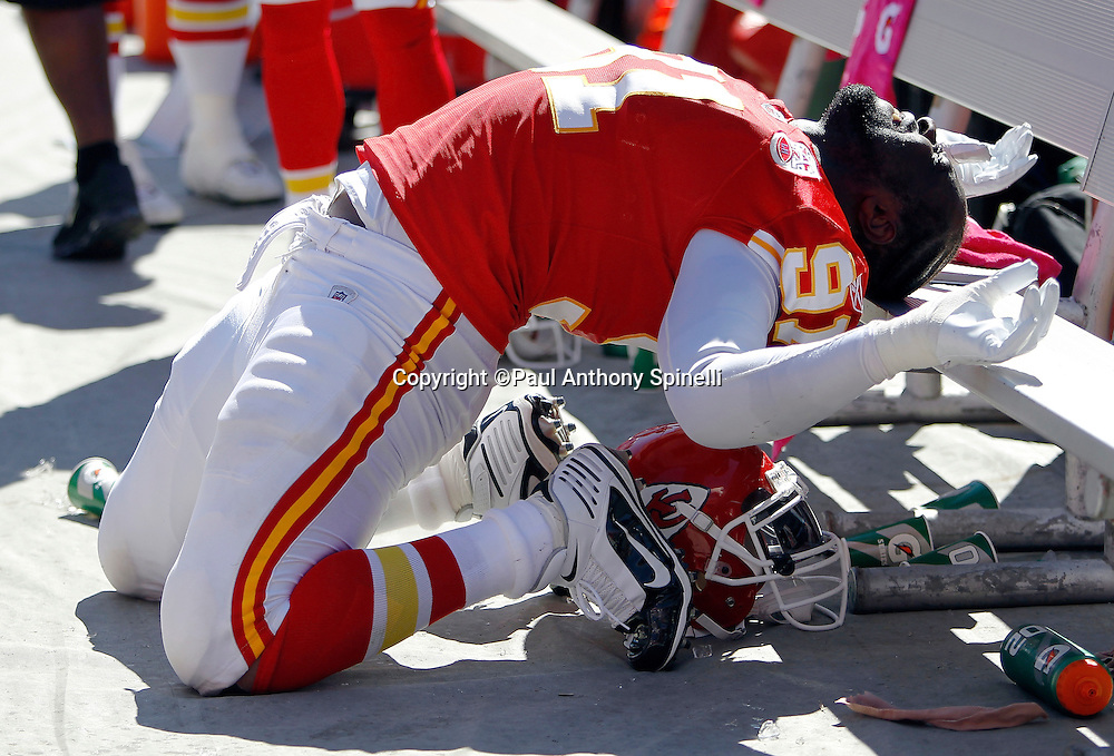 Kansas City Chiefs outside linebacker Tamba Hali (91) stretches backward using the sideline bench during the NFL week 4 football game against the Minnesota Vikings on Sunday, October 2, 2011 in Kansas City, Missouri. The Chiefs won the game 22-17. ©Paul Anthony Spinelli
