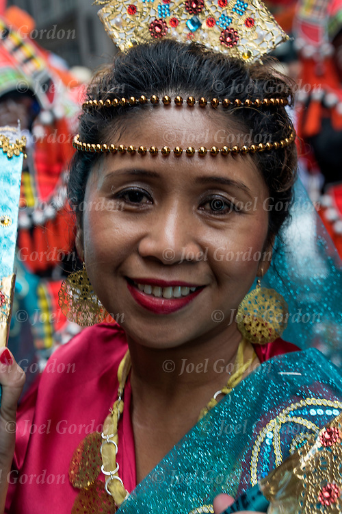 Ethnic Pride for Filipinos in the Philippine Day Day Parade. She is wearing Carnival regalia and headdress.