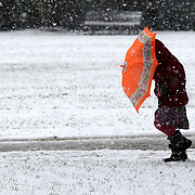 PEOPLE IN CAMBRIDGE ON MONDAY MORNING AS HEAVY SNOW HIT THE AREA...Snow and heavy rain brought Monday morning gloom and more travel disruption to many areas of the UK today with the wintry weather set to continue for the rest of the week...Luton airport runway was closed after severe weather in Bedfordshire meant snow had to be cleared, leading to flight cancellations and delays...Snow fell in large parts of southern England, with Gloucestershire, Oxfordshire,Cambridgeshire, Buckinghamshire and Suffolk all affected..