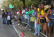 Spectators line the parade route along Eastern Parkway in Brooklyn, to view elaborate costumes, and enjoy steel drum music during the West Indian  parade.