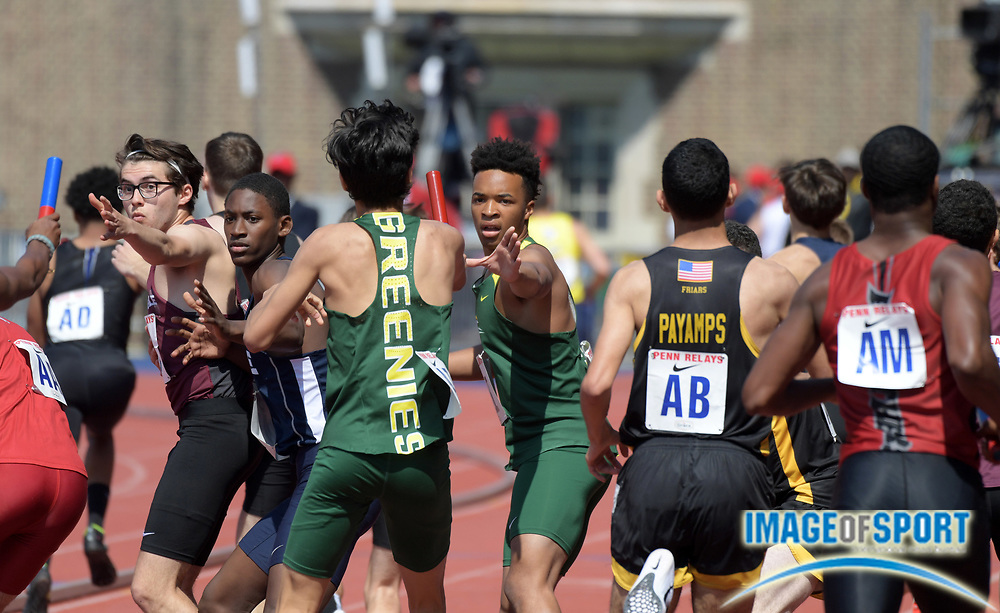 Apr 28, 2018; Philadelphia, PA, USA; Runners prepare to take the handoff in a boys 4 x 400m relay heat during the 124th Penn Relays at Franklin Field.