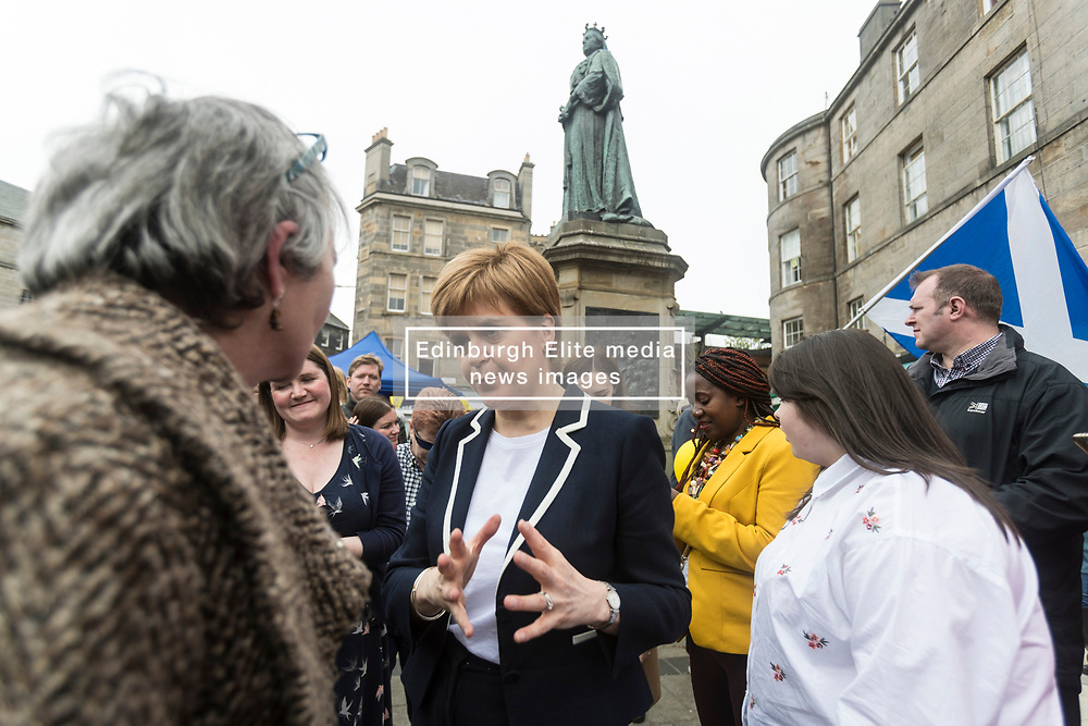 The First Minister, Nicola Sturgeon, campaigning in Leith by campaigning that the SNP will be a voice for young people.<br /> <br /> Pictured: 'Queen of Scotland' Nicola Sturgeon under the statue of Queen Victoria