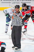 KELOWNA, CANADA - DECEMBER 7: Referee Duncan Brow stands at centre ice on December 7, 2016 at Prospera Place in Kelowna, British Columbia, Canada.  (Photo by Marissa Baecker/Shoot the Breeze)  *** Local Caption ***