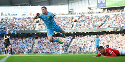 MANCHESTER, ENGLAND - Sunday, November 2, 2014: Manchester City's James Milner is fouled by Manchester United's Chris Smalling, for which he received a second yellow card and was sent off, during the Premier League match at the City of Manchester Stadium. (Pic by David Rawcliffe/Propaganda)