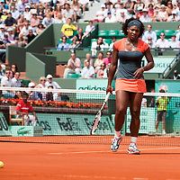 3 June 2009: Serena Williams of USA looks dejected as she watches the ball falling inside the lines during the Women's single quarter final match on day eleven of the French Open at Roland Garros in Paris, France.