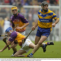 24 July 2005; Sean McMahon, Clare, in action against Michael Jordan and Eoin Quigley, centre, Wexford. Guinness All-Ireland Senior Hurling Championship Quarter-Final, Wexford v Clare, Croke Park, Dublin. Picture credit; Damien Eagers / SPORTSFILE