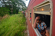 People looking through open train window, Sri Lanka