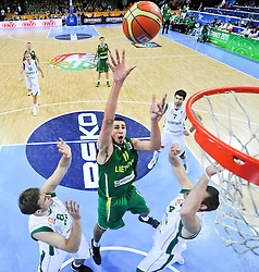 Jonas Valanciunas of Lithuania vs Matjaz Smodis of Slovenia and Uros Slokar of Slovenia during basketball game between National basketball teams of Slovenia and Lithuania at of FIBA Europe Eurobasket Lithuania 2011, on September 15, 2011, in Arena Zalgirio, Kaunas, Lithuania. Lithuania defeated Slovenia 80-77.  (Photo by Vid Ponikvar / Sportida)