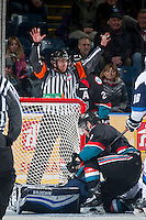 KELOWNA, CANADA - DECEMBER 3: Referee Jeff Ingram makes a call between the Kelowna Rockets and the Saskatoon Blades on December 3, 2014 at Prospera Place in Kelowna, British Columbia, Canada.  (Photo by Marissa Baecker/Shoot the Breeze)  *** Local Caption *** Jeff Ingram;