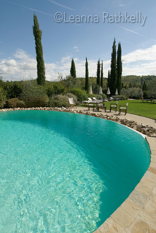 The pool and garden at Canonica di Cortine offers an elegant place to relax, in Tuscany, Italy.
