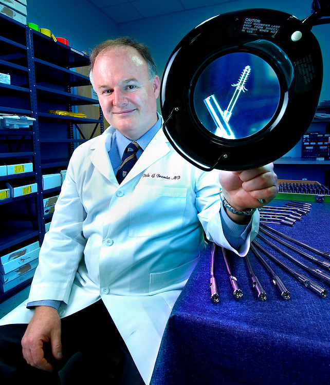 Portrait of an Orthopedic Surgeon holding new hardware implants.  Photographed for the Maddux Business Report.