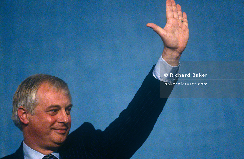 Secretary of State for the Environment and Conservative MP, Chris Patten waves to the audience after his speech at the Conservative party conference on 11th October 1991 in Blackpool, England.