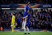 Chelsea FC midfielder Ruben Loftus-Cheek (12) is lifted into the air by Chelsea FC midfielder Cesc Fabregas (4)after scoring his third goal 3-0 Chelsea during the Europa League group stage match between Chelsea and BATE Borisov at Stamford Bridge, London, England on 25 October 2018.