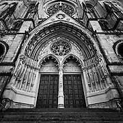 Gritty black and white image of the entrance of the Cathedral Church of Saint John the Divine, New York City.