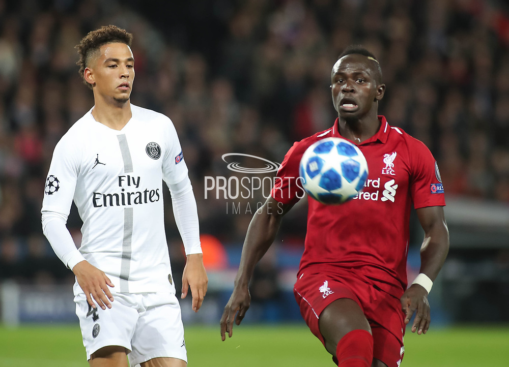 Sadio Mane of Liverpool against Thilo Kehrer of Paris Saint-Germain during the Champions League group stage match between Paris Saint-Germain and Liverpool at Parc des Princes, Paris, France on 28 November 2018.