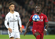 Sadio Mane of Liverpool against Thilo Kehrer of Paris Saint-Germain during the Champions League group stage match between Paris Saint-Germain and Liverpool at Parc des Princes, Paris, France on 28 November 2018.