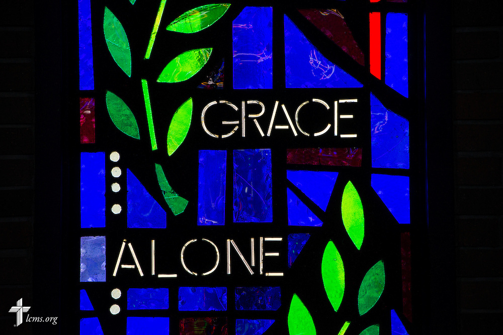 "Stained glass with the words ""Grace Alone"" on Sunday, Nov. 22, 2015, at Salem Lutheran Church in Springdale, Ark. LCMS Communications/Erik M. Lunsford"