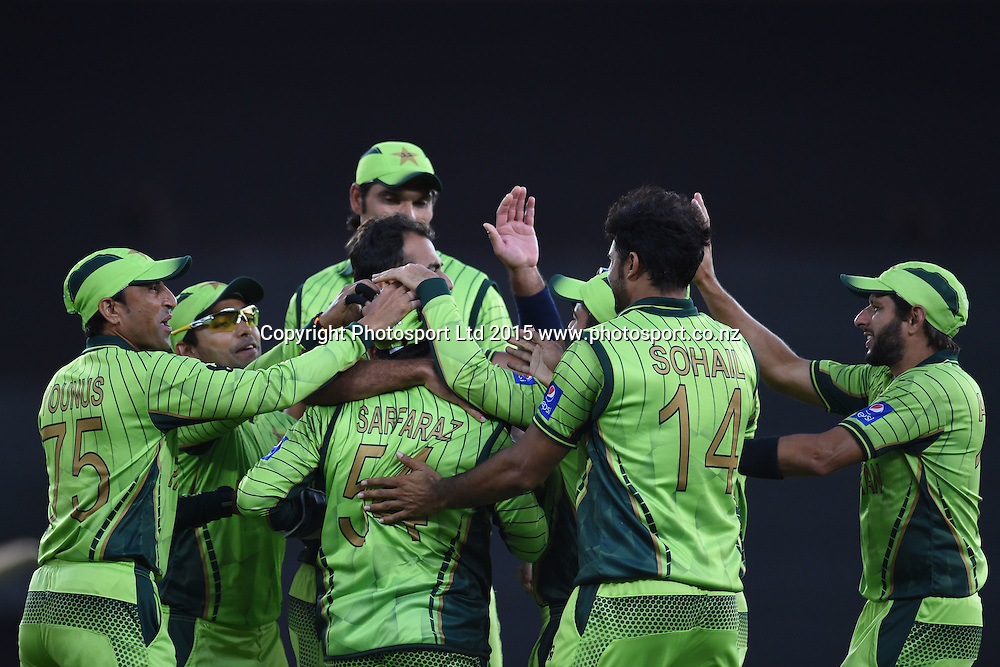 Pakistan players celebrate a wicket during the ICC Cricket World Cup match between Pakistan and South Africa at Eden Park in Auckland, New Zealand. Saturday 07 March 2015. Copyright Photo: Raghavan Venugopal / www.photosport.co.nz