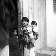 Claudia and her younger sister Jessica arrive home from school in Nebaj, Guatemala -- a small town in the country's western highlands. Their mother is a weaver and they'll both become weavers as well.
