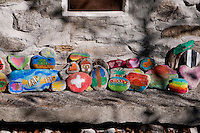 Painted stones at a stone cottage at the end of Valle Verzasca in Ticino, Southern Switzerland.