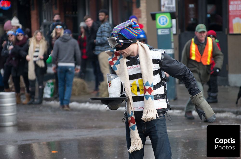 A man wearing snowshoes runs with a pitcher full of ice during a winter themed bar-back competition. Staff from bars around the ByWard Market went head to head in the competition. January 31, 2016. Brendan Montgomery/Captis Photos