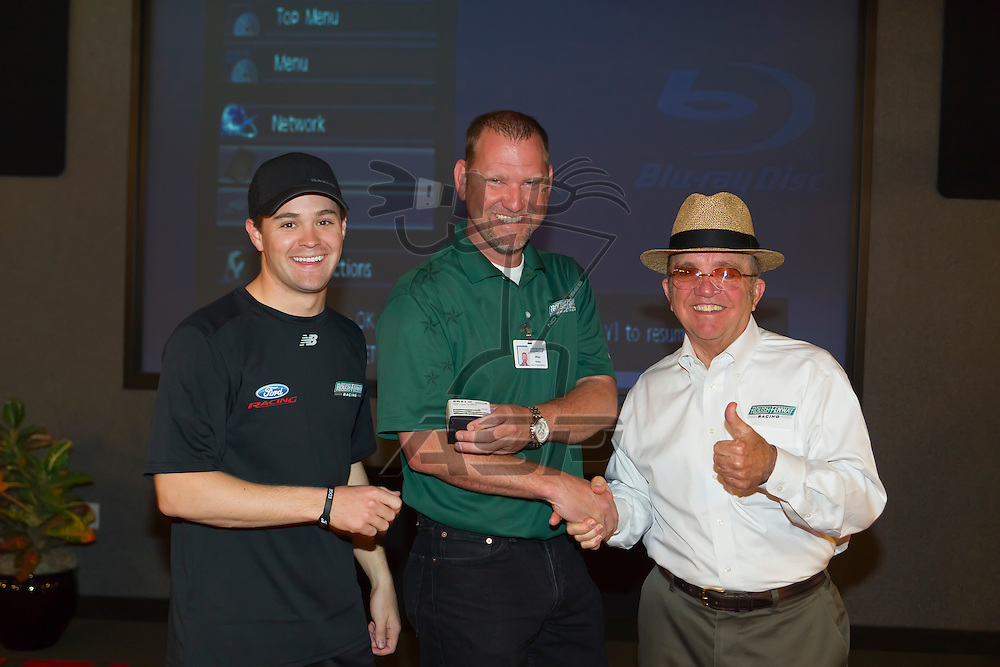 CONCORD, NC - MAR 13, 2012:  NASCAR Nationwide champion, Ricky Stenhouse, Jr. (6) and team owner, Jack Roush, present their 2011 Nationwide Champion rings to the #6 Roush Fenway Racing team at Roush Fenway Racing headquarters in Concord, NC.