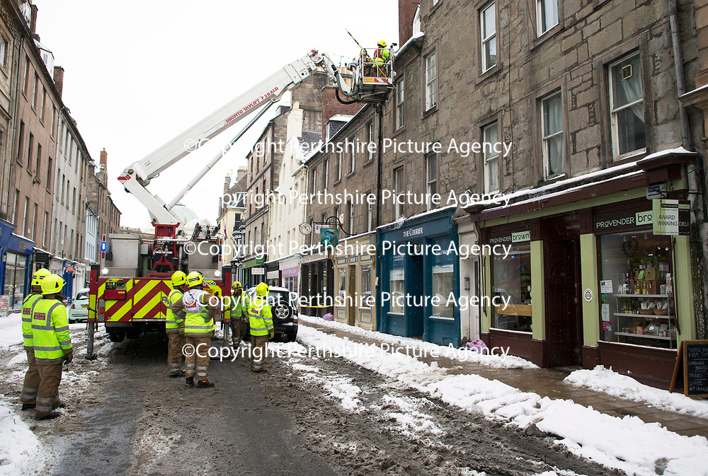 Beast from the East Weather….02.03.18<br />Firefighters from the Scottish Fire & Rescue Service in Perth pictured at work removing dangerous icicles from buildings on the city's George Street as the cold and snowy weather conditions continue….<br />Picture by Graeme Hart.<br />Copyright Perthshire Picture Agency<br />Tel: 01738 623350  Mobile: 07990 594431