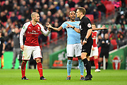 Jack Wilshere (10) of Arsenal is upset that he was not awarded a free kick by referee Craig Pawson with Fernandinho (25) of Manchester City with his arms out during the EFL Cup Final match between Arsenal and Manchester City at Wembley Stadium, London, England on 25 February 2018. Picture by Graham Hunt.