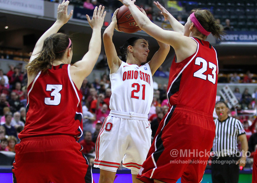 March 03, 2012; Indianapolis, IN, USA; Ohio State Buckeyes guard Samantha Prahalis (21) tries to pass off the ball as Nebraska Cornhuskers forward Hailie Sample (3) and Nebraska Cornhuskers forward Emily Cady (23) defend during the semifinals of the 2012 Big Ten Tournament at Bankers Life Fieldhouse. Nebraska defeated Ohio State 77-62. Mandatory credit: Michael Hickey-US PRESSWIRE