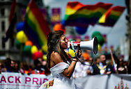 A women dressed as a bide attends the annual Gay Pride parade in London, Britain, 29 June 2013. BOGDAN MARAN / BPA