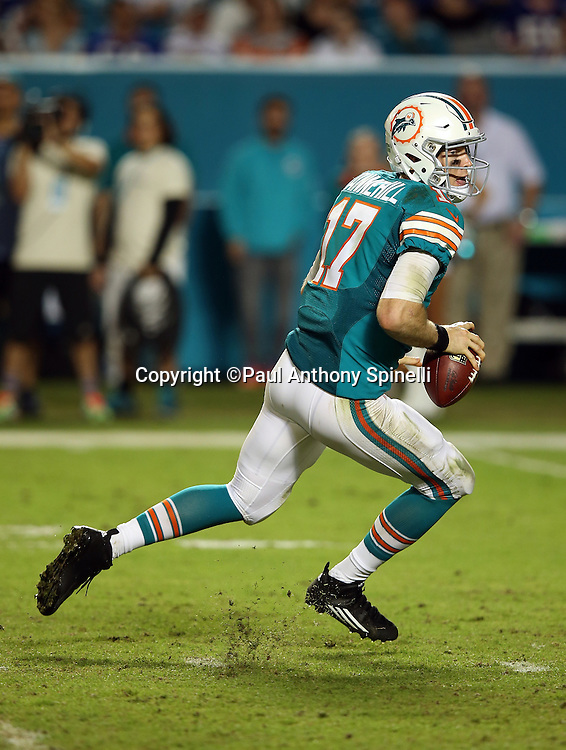 Miami Dolphins quarterback Ryan Tannehill (17) scrambles during the NFL week 14 regular season football game against the New York Giants on Monday, Dec. 14, 2015 in Miami Gardens, Fla. The Giants won the game 31-24. (©Paul Anthony Spinelli)