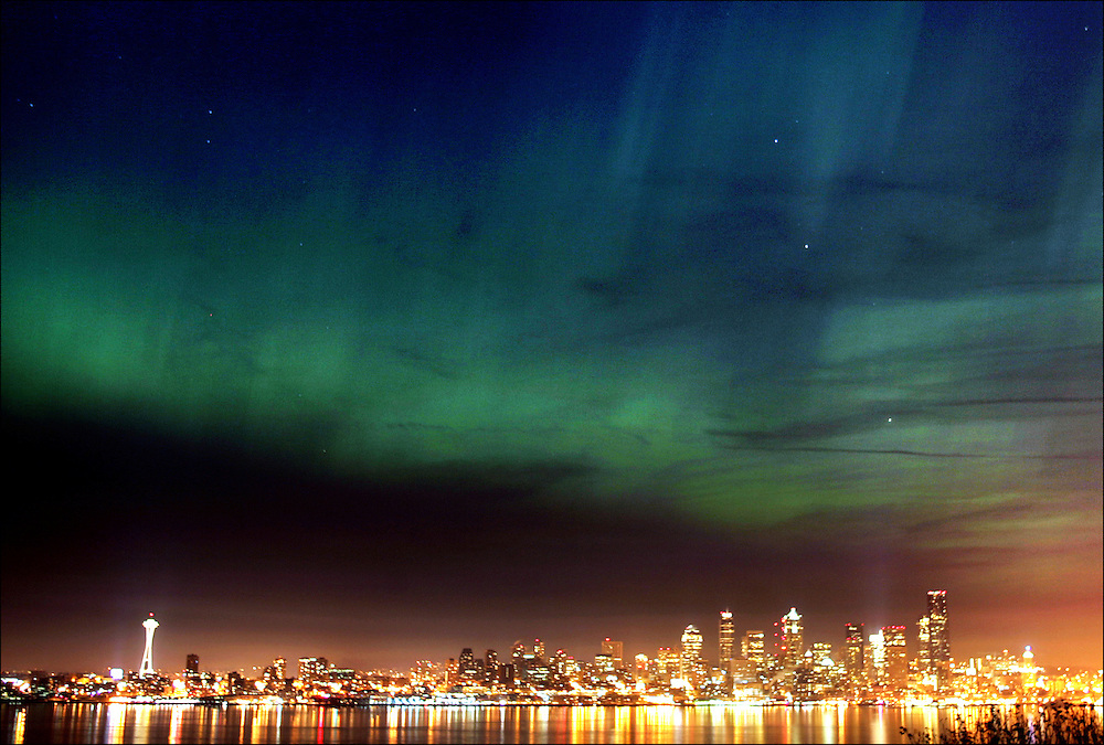 The Northern Lights shimmer across the Seattle skyline as seen from Hamilton Viewpoint in West Seattle. The rare phenomenon took place as an extreme geomagnetic storm raged in the upper atmosphere, sending high-energy particles emitted by the sun sweeping over Earth, making the aurora borealis visible as far south as Oklahoma.<br />