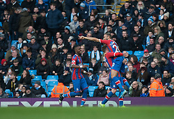 Cenk Tosun of Crystal Palace (Top) celebrates after scoring his sides first goal - Mandatory by-line: Jack Phillips/JMP - 18/01/2020 - FOOTBALL - Etihad Stadium - Manchester, England - Manchester City v Crystal Palace - English Premier League