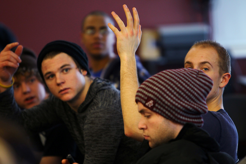 3/7/11 5:18:23 PM -- Minneapolis, MN, U.S.A.---.Students Chris Smith, 23, second from left (in black hat) of Brighton, MI, and Mark Spicer, 22, far right, of Glencoe, IL, ask questions about housing applications for the next semester during a StepUP all-house Circle meeting at Augsburg College in downtown Minneapolis March 7, 2011.  The weekly gathering is both a business meeting and a chance to share recovery successes and struggles..---.Photo by Courtney Perry, Freelance.