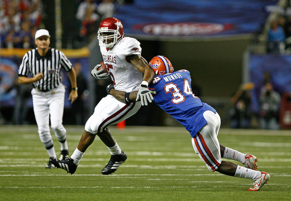 Arkansas RB Darren McFadden is tackled by Florida safety Dorian Munroe during the SEC Championship game between the Arkansas Razorbacks and the Florida Gators at the Georgia Dome in Atlanta, GA on December 2, 2006.<br />