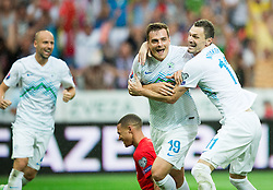 Nejc Pecnik of Slovenia and Milivoje Novakovic of Slovenia celebrate after Pecnik scored second goal for Slovenia during the EURO 2016 Qualifier Group E match between Slovenia and England at SRC Stozice on June 14, 2015 in Ljubljana, Slovenia. Photo by Vid Ponikvar / Sportida