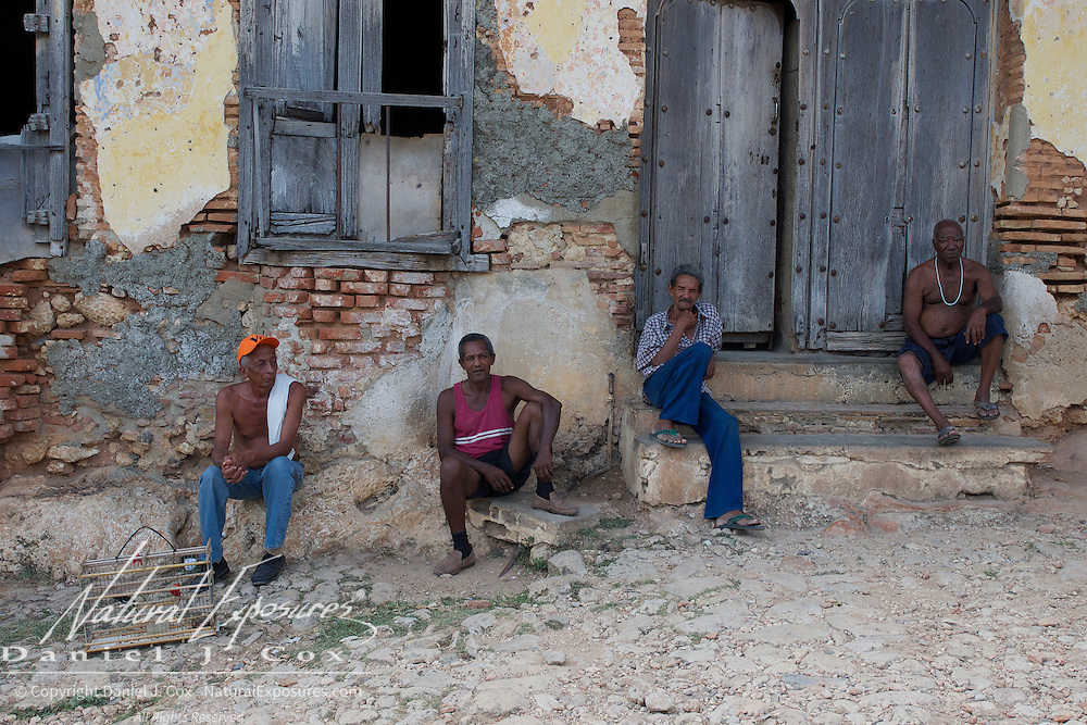 Four older gentleman killing time on the streets of Trinidad, Cuba.