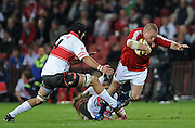 Gethin Jenkins of the British Lions is tackled by Lions locks Willem Stoltz and no.4 Brad Mockford.<br /> Rugby - 090602 - British&Irish Lions v Xerox Lions - Coca-Cola Park - Johannesburg - South Africa. The British Lions won 74-10 scoring 10 tries.<br /> Photographer : Anton de Villiers / SASPA