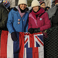 Kiani (R) and sister Kalia Yasak(L) of Kula Maui, Hawaii arrive at the reflecting pool at the Capital carrying an Hawaiian flag for the swearing in of Barack Obama as the 44th President of the United States of America during his Inauguration Ceremony on Capitol Hill in Washington on January 20, 2009.    (Mark Goldman/ Goldmine Photos)