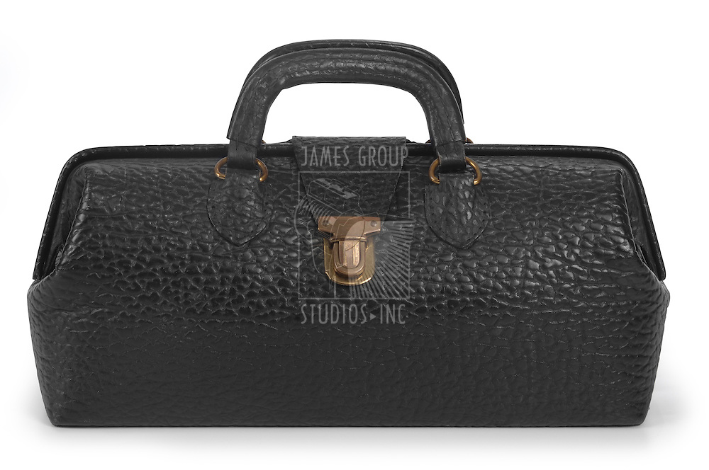 Vintage, black medical bag in closed position isolated on white with clipping path