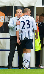 BOLTON, ENGLAND - Saturday, August 29, 2009: Bolton Wanderers' Sean Davis leaves the pitch and is consoled by Bolton Wanderers manager Gary Megson after being sent off during the Premiership match against Liverpool at the Reebok Stadium. (Photo by David Rawcliffe/Propaganda)