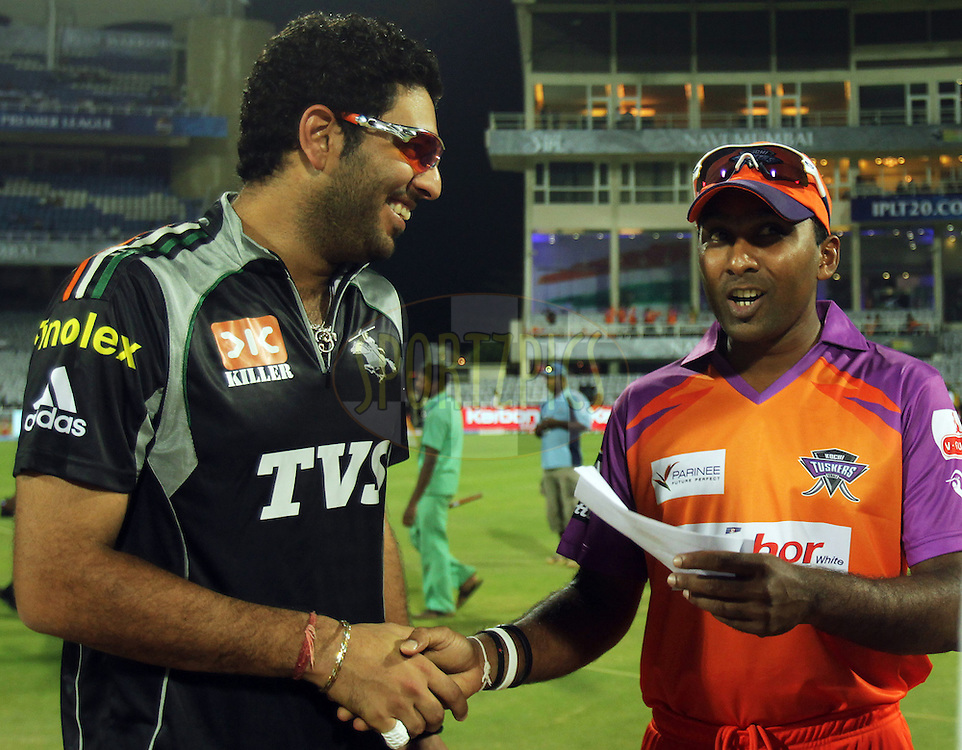 Pune Warriors captain Yuvraj Singh and Mahela Jayawardene captain of Kochi Tuskers Kerala shakes hands during  match 10 of the Indian Premier League ( IPL ) Season 4 between the Pune Warriors and the Kochi Tuskers Kerala held at the Dr DY Patil Sports Academy, Mumbai India on the 13th April 2011..Photo by BCCI/SPORTZPICS