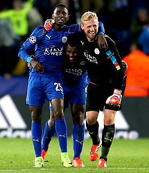 Kasper Schmeichel, Wilfred Ndidi and Wes Morgan of Leicester City celebrate their sides win over Sevilla - Mandatory by-line: Robbie Stephenson/JMP - 14/03/2017 - FOOTBALL - King Power Stadium - Leicester, England - Leicester City v Sevilla - UEFA Champions League round of 16, second leg