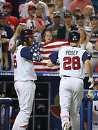 March 12, 2017 - Miami, FL, USA - United States catcher Buster Posey is congratulated by teammate shortstop Brandon Crawford after hitting a solo home run during the seventh inning of a World Baseball Classic first round Pool C game against Canada on Sunday, March 12, 2017 at Marlins Park in Miami, Fla. (Credit Image: © David Santiago/TNS via ZUMA Wire)