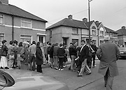 """John O'Grady Rescued By Gardai.   (R67)..1987..05.11.1987..11.05.1987..5th November 1987..After being kidnapped from his home in Cabinteely, Co Dublin, John O'Grady was finally rescued after twenty one days in captivity. he was located in a house inCarnlough Road, Cabra West, Dublin. During his ordeal Mr O""""Grady was mutilated by the kidnappers led by Dessie O'Hare to apply pressure on his family to pay the ransom sought. In an ensuing gun battle with the kidnappers a detective garda was shot and seriously wounded. In the chaos that followed the kidnappers escaped and were not all captured for a further three weeks after a massive manhunt...Residents of Carnlough Road congregate on the road outside the house where John O'Grady was held."""