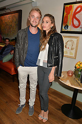 TOM FELTON and JADE OLIVIA at the 50th anniversary party for Daphne's restaurant, 112 Draycott Avenue, London held on 24th June 2014.