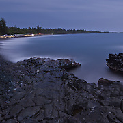 Black Sand beach in Hana. The shutter for this shot was open for 15 mins. The main source of the light was the full moon diffused by clouds. Hana, HI.