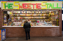 Sweet shop confectionary stall in barrow land Market , Gallowgate, Glasgow , United Kingdom