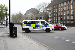 © Licensed to London News Pictures. 07/04/2019. London, UK. A police van on Holloway Road in Islington, north London. Police officers and paramedics were called after a woman in her 20s, was stabbed inside a home in Holloway north London, just after 11pm on Saturday 6 April 2019. According to the Met Police, the victim was rushed to a north London hospital, where she was being treated for injuries that are not life-threatening. A 23-year-old man was arrested near to the stabbing scene on suspicion of grievous bodily harm. Photo credit: Dinendra Haria/LNP