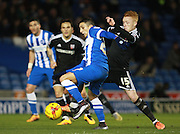Brighton striker Anthony Knockaert gets the better of Brentford midfielder Ryan Woods before shooting to open the scoring during the Sky Bet Championship match between Brighton and Hove Albion and Brentford at the American Express Community Stadium, Brighton and Hove, England on 5 February 2016. Photo by Bennett Dean.